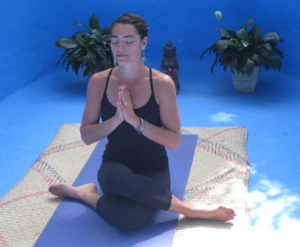 A guest practicing yoga