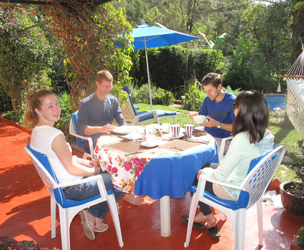 Guests Enjoying a Sunny Breakfast